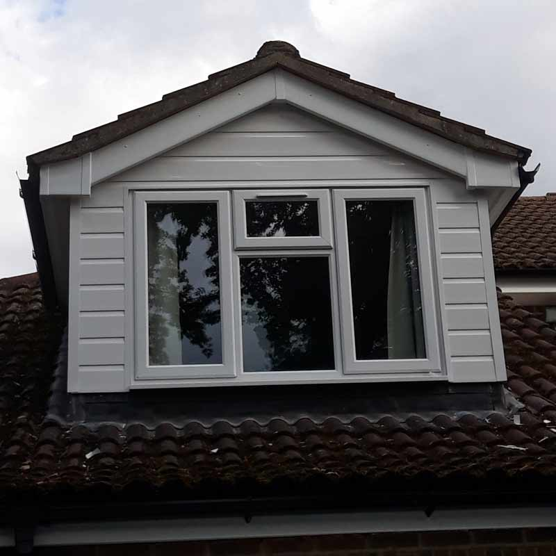 wooden cladding around dormer window replaced with uPVC cladding