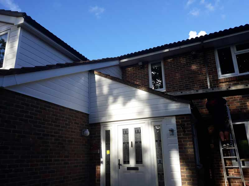 wooden cladding replaced with uPVC cladding above front door